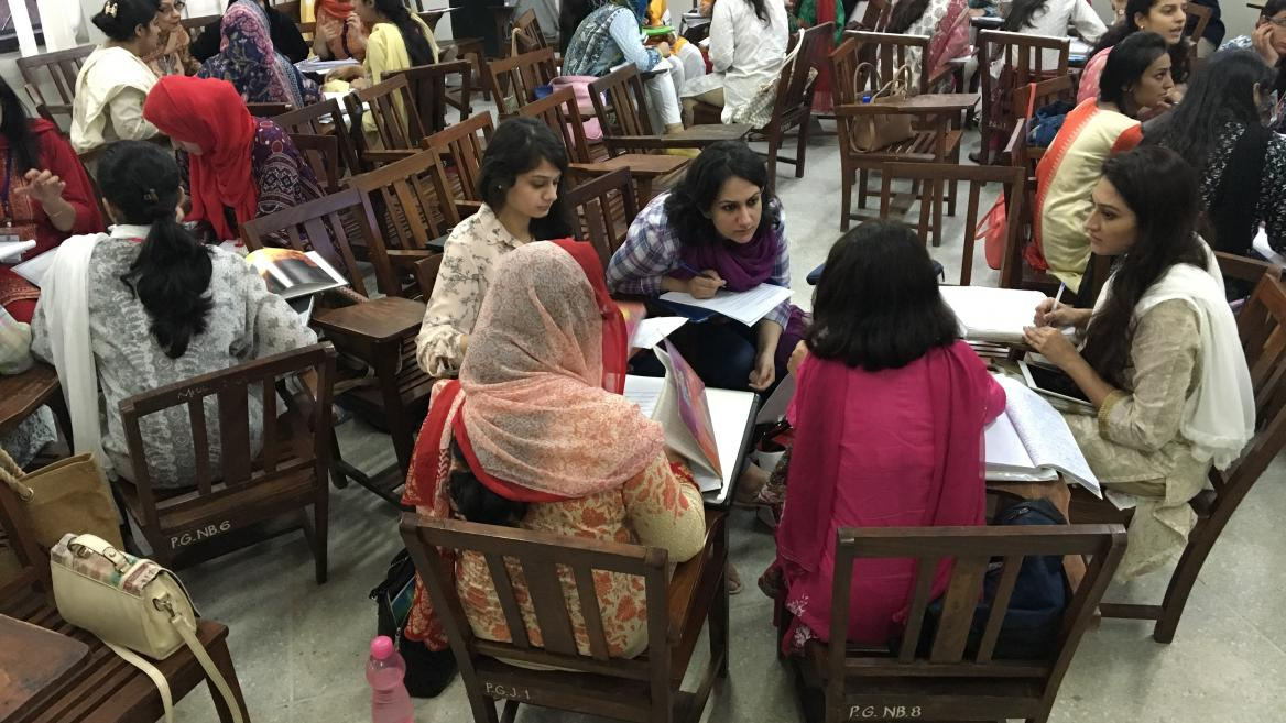 women learning in a classroom