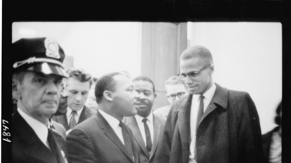 Martin Luther King and Malcolm X waiting for press conference, 1964. Photo by Marion S. Trikosko. Image from Library of Congress; no known restrictions on usage.